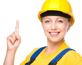 Young construction worker pointing up — Stock Photo