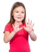 Portrait of a little girl making stop gesture — Stock Photo