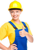 Young construction worker is showing thumb up sign — Stock Photo