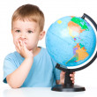 Little boy with a globe — Stock Photo #28564997