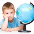 Little boy with a globe — Stock Photo #28824125