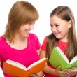 Mother and her daughter are reading books — Stock Photo