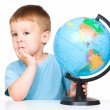 Little boy with a globe — Stock Photo #29127591