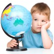 Little boy with a globe — Stock Photo #29127905
