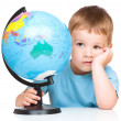 Little boy with a globe — Stock Photo