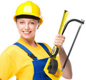 Young construction worker with hacksaw — Stock Photo