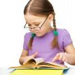 Stock Photo: Little girl is reading book
