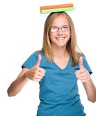 Young student girl is showing thumb up gesture — Stock Photo
