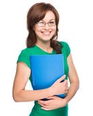 Young skinny student girl is holding exercise book — Stock Photo