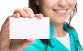 Doctor is showing her business card — Stock Photo