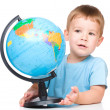 Stock Photo: Happy little boy with globe