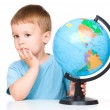 Little boy with a globe — Stock Photo #29898683