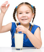 Cute little girl with a glass of milk — Stock Photo
