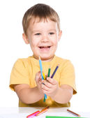 Little boy is playing with color pencils — Stock Photo