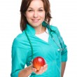 Young lady doctor is holding a red apple — Stock Photo #29948761