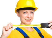 Young construction worker with tape measure — Stock Photo