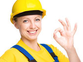 Young construction worker is showing OK sign — Stock Photo
