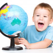 Happy little boy with globe — Stock Photo #30110003