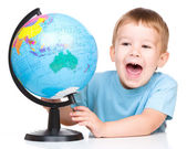 Happy little boy with a globe — Stock Photo