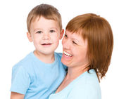 Portrait of a happy mother hugging her son — Stock Photo