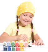 Cute cheerful child play with paints — Stock Photo