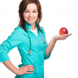 Young lady doctor is holding a red apple — Stock Photo #30848923