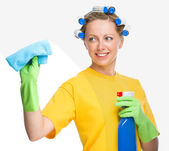 Young woman is cleaning glass using rag — Stock Photo