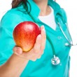 Lady doctor is holding a red apple — Stock Photo