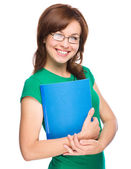 Young skinny student girl is holding exercise book — Стоковое фото