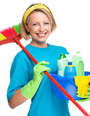 Young woman as a cleaning maid — Stock Photo