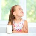 Постер, плакат: Sad little girl with a glass of milk