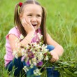 Portrait of a little girl with flowers — Stock Photo
