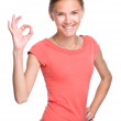 Young teen girl is showing OK sign — Stock Photo