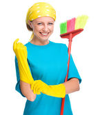 Young woman as a cleaning maid — Стоковое фото