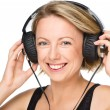 Young woman enjoying music using headphones — Stock Photo #32156523
