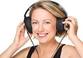 Young woman enjoying music using headphones — Zdjęcie stockowe