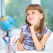 Little girl is drawing using color pencils — Stock Photo #32208969