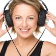 Young woman enjoying music using headphones — Stock Photo #32271913