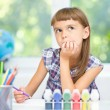Little girl is drawing using color pencils — Stock Photo #32272307