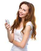 Young woman is pleased by incoming message — Stock Photo