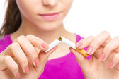 Young woman is breaking a cigarette — Stock Photo