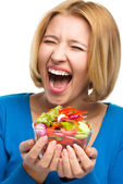Young happy woman with salad — Stock Photo