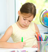 Cute cheerful child drawing using felt-tip pen — Stock Photo