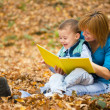 Mother is reading book with her son — Stock Photo #34845009