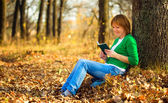 Portrait of a woman in autumn park — Stock Photo