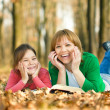 Mother is reading book with her daughter — Stock Photo #35876163