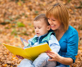 Mother is reading from tablet with her son — Stock Photo
