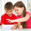 Children are using tablet — Stock Photo