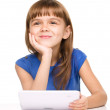 Young girl is using tablet — 图库照片
