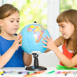 Little girls are examining globe — Stock Photo